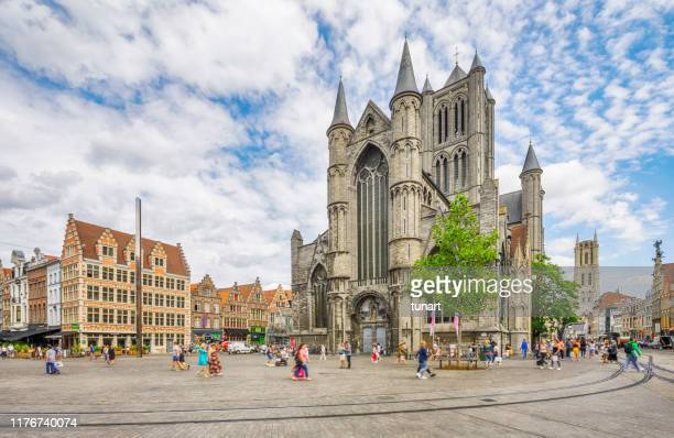 st nicholas' church and korenmarkt (central square) of ghent, belgium - st. nicholas cathedral stock pictures, royalty-free photos & images