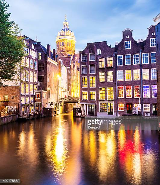 St Nicholas Church with Reflection in Amsterdam Canal Netherlands