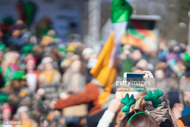st patrick day parade in city - parade stock pictures, royalty-free photos & images