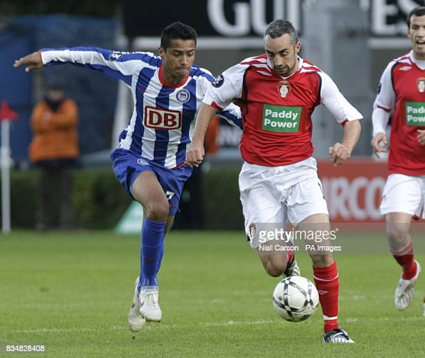 St Patrick's Athletic's Gary Dempsey and Hertha Berlin's Santos Cicero battle for the ball