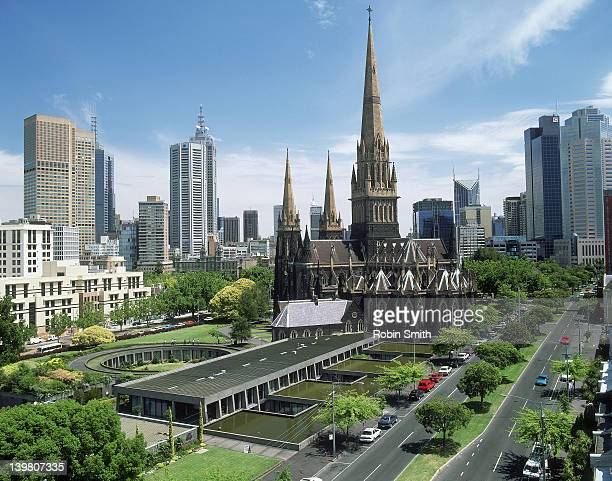 st patrick's cathedral with city skyline, melbourne, victoria, 1999 - 1999 stock pictures, royalty-free photos & images