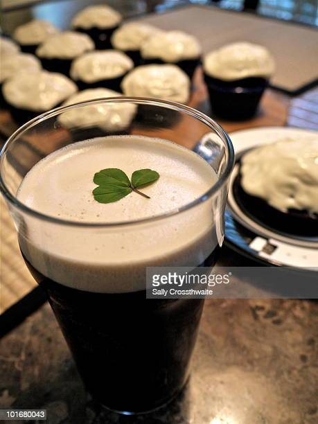 st patrick's day guinness and cupcakes - guinness stock photos and pictures