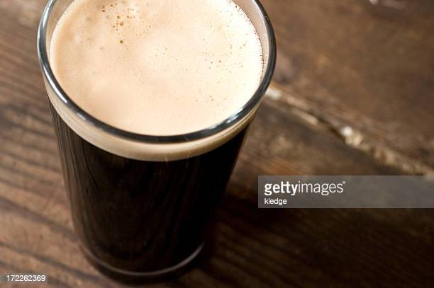 St. Patrick's day stout pint on a wooden surface