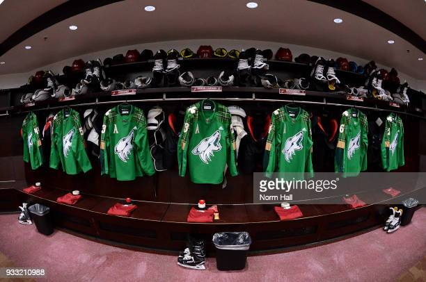 St Patrick's Day style jerseys hang in the Arizona Coyotes lockers prior to a game against the Minnesota Wild at Gila River Arena on March 17 2018 in...