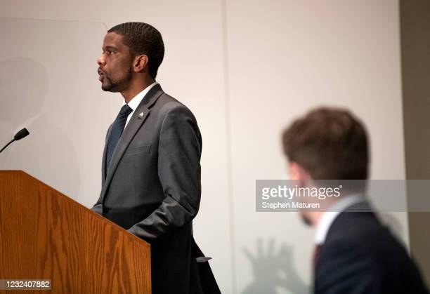 St. Paul Mayor Melvin Carter speaks at a press conference about public safety as Minneapolis Mayor Jacob Frey listens on April 19, 2021 in St. Paul,...