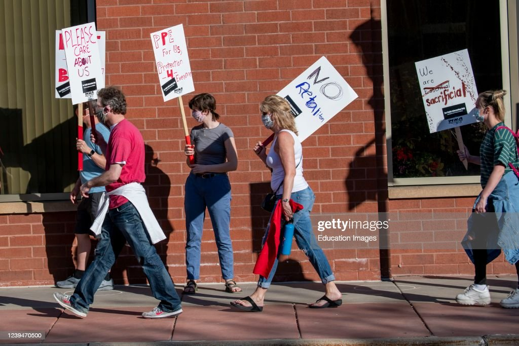 Nurses protest the lack of masks and scrubs during the pandemic.. They are demanding equipment, training, staffing and transpaency from United hospital and other hospitals. : News Photo