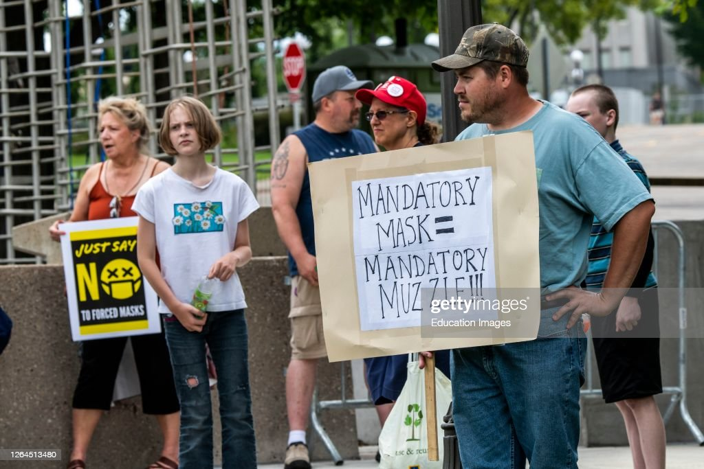 Protest to unmask minnesota.  Protesters not wearing masks rally to undo the mandatory mask wearing put in place by governor Walz. : News Photo