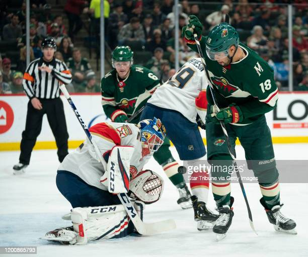 St. Paul, MN January 20: A puck bounced in front of Florida Panthers goaltender Sergei Bobrovsky and Minnesota Wild left wing Jordan Greenway in the...