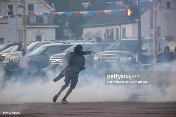 Protestors ran as St Paul police fired tear gas along University Avenue