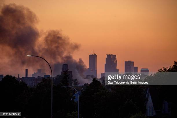 The sun set over the Twin Cities as smoke hovers over St Paul along University Avenue