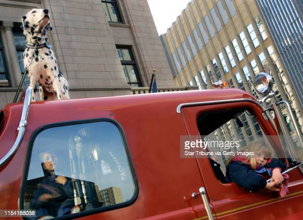 1/26/02 St Paul MN Mild weather Saturday made it possible for fouryearold Michaela Schadt to hang out the window of her father's antique firetruck...