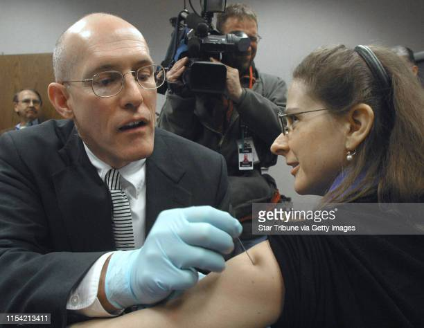 St Paul MN Wednesday 2/1/2003 Dr Greg Poland of the Mayo Clinic vaccinated Dr Ruth Lynfield against smallpox during a demonstration staged by the...