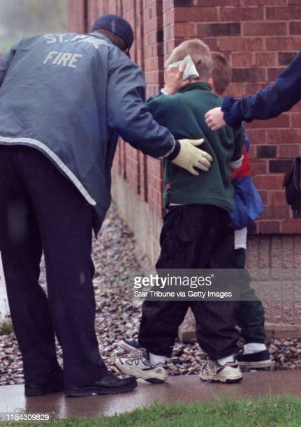 St Paul paramedics and teacher Kelly Anderson walked 3rd grader Trent Lukin and two other children to a waiting ambulance Nine students from the...
