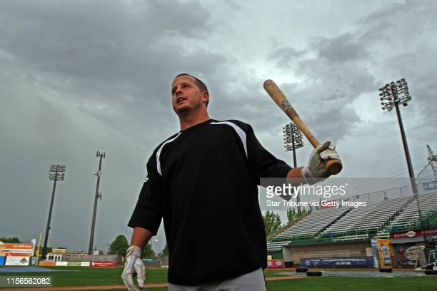 St Paul Saints hopefull Chris Cates of Brandon FL checked out the field after a burst of thunderstorms shut down the annual open tryouts for the team...