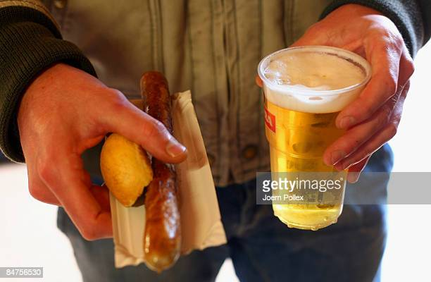 St Pauli fan is seen with a beer an a sausage prior to the 2 Bundesliga match between FC St Pauli and SpVgg Greuther Fuerthg at the Millerntor...