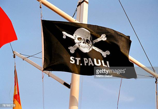 st pauli flag on the reeperbahn in hamburg - reeperbahn stock pictures, royalty-free photos & images