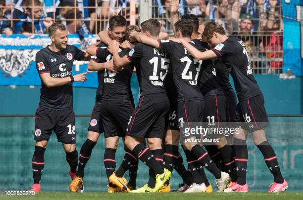 St Pauli players celebrate the 21 goal during the 2nd divisionBundesliga soccer match betweenVfL Bochum and FCSt Pauli in the Vonovia Ruhrstadion...