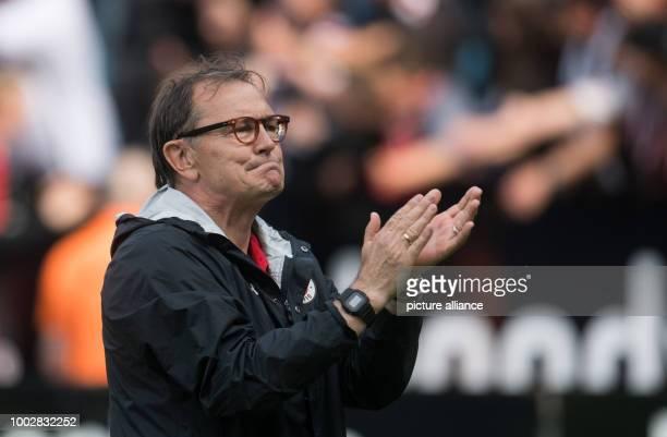 St Pauli's coach Ewald Lienen celebrates after the 2nd divisionBundesliga soccer match betweenVfL Bochum and FCSt Pauli in the Vonovia Ruhrstadion...