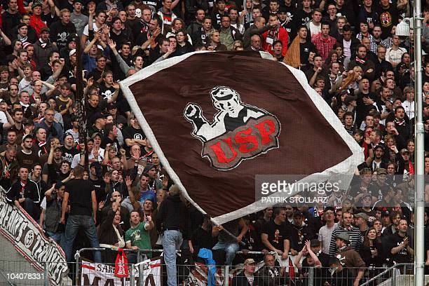 DFL St Pauli's fans cheer on their team during the German first division Bundesliga football match 1 FC Cologne vs FC St Pauli in the western German...