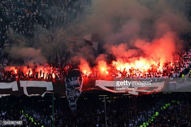 St Paulis Fans set off flares during the Second Bundesliga match between Hamburger SV and FC St Pauli at Volksparkstadion on September 30 2018 in...