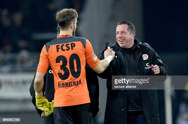 St Pauli's goalkeeper Robin Himmelmann and trainer Markus Kauczinski celebrate their teams's victory of 21 at the end of the German 2nd Bundesliga...
