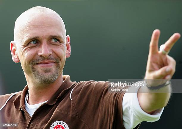 St. Paulis Team Manager celebrates after the German Football Association Cup first round victory against Bayer Leverkusen at the Millerntor Stadium...
