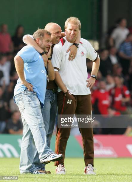 St. Paulis Team Manager Holger Stanislawski celebrates with Assistant Coach Klaus Peter Nemet and Head Coach Andre Trulsen after the German Football...
