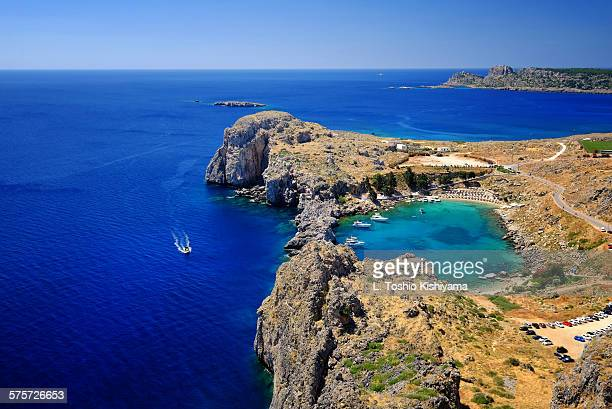 st. paul's bay in lindos, greece - rhodes dodecanese islands stock photos and pictures