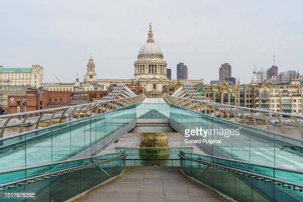 st pauls cathedral and an empty millennium bridge during the pandemic lockdown in london (uk) - city stock pictures, royalty-free photos & images