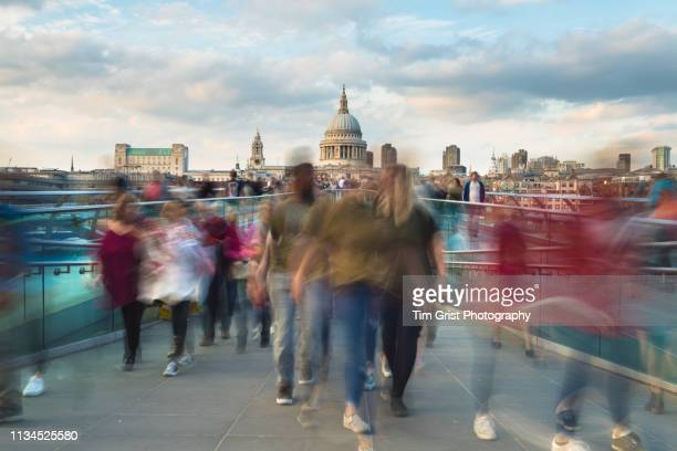 st paul's cathedral and commuters on the millennium bridge, london - long exposure stock pictures, royalty-free photos & images