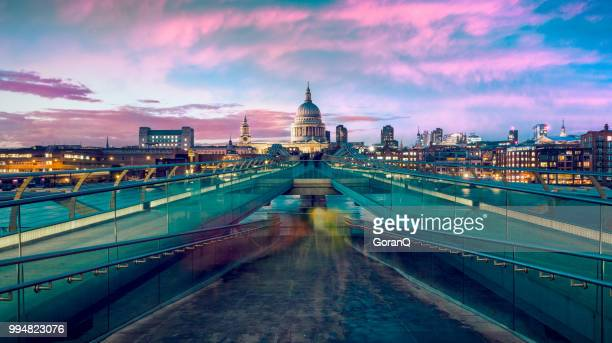st pauls cathedral and millennium bridge at dusk in london, uk. - london stock pictures, royalty-free photos & images