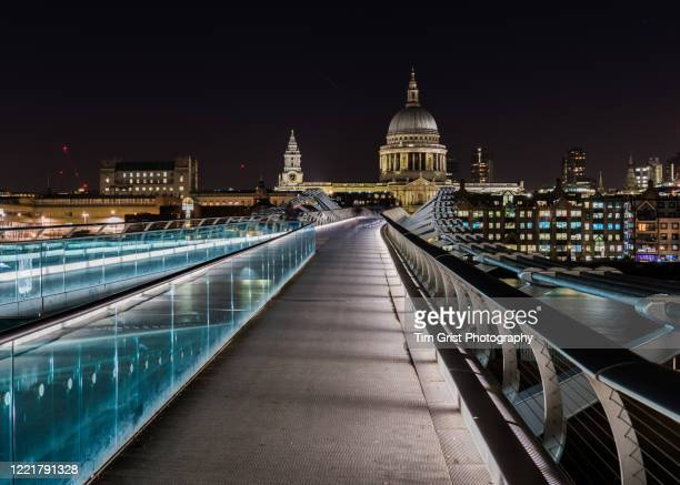 st paul's cathedral and millennium bridge at night. london - atmospheric mood stock pictures, royalty-free photos & images