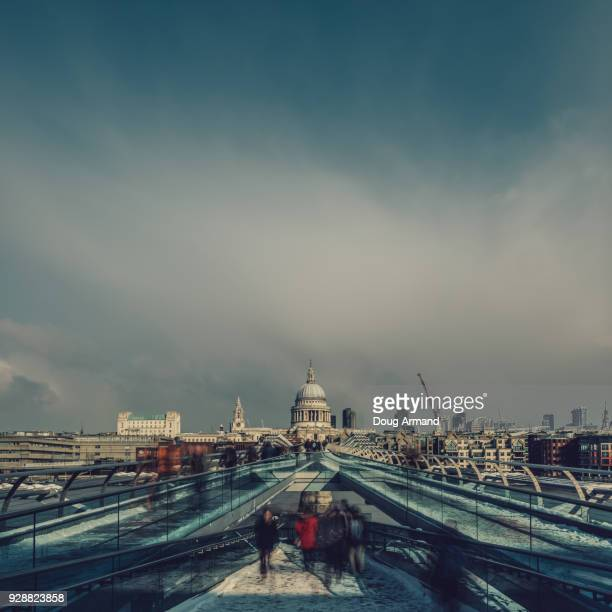 St Paul's Cathedral and millennium Bridge on a snowy morning, London, UK