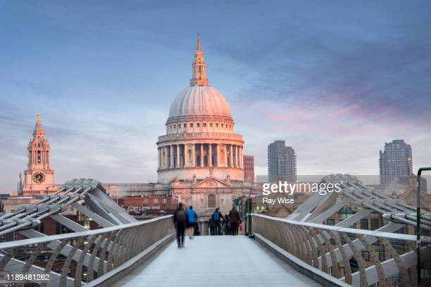 st pauls cathedral at sunrise from millennium footbridge. - christianity stock pictures, royalty-free photos & images