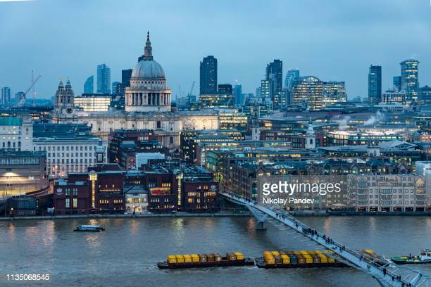 st paul's cathedral during twilight hours as seen from high angle on the south bank - stock image - st. paul's cathedral london stock pictures, royalty-free photos & images
