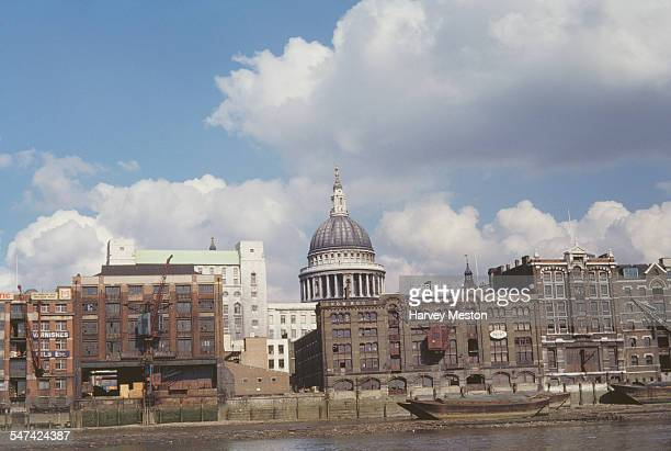 St Paul's Cathedral in London England with the Carron Warehouse in the foreground on the banks of the River Thames 1961
