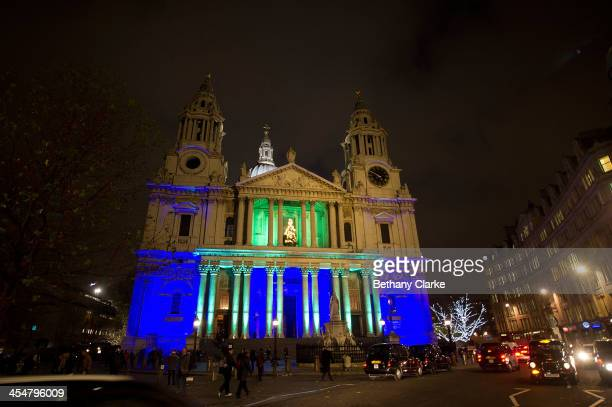 St Paul's Cathedral is lit up in blue and green to mark the Standard Chartered charity carol service on December 10 2013 in London England
