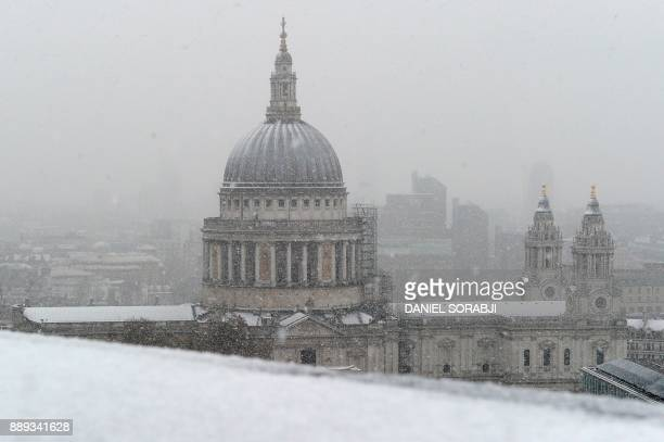 St Paul's Cathedral is seen as snow falls over central London on December 10 2017 Heavy snow fell across northern and central parts of England and...