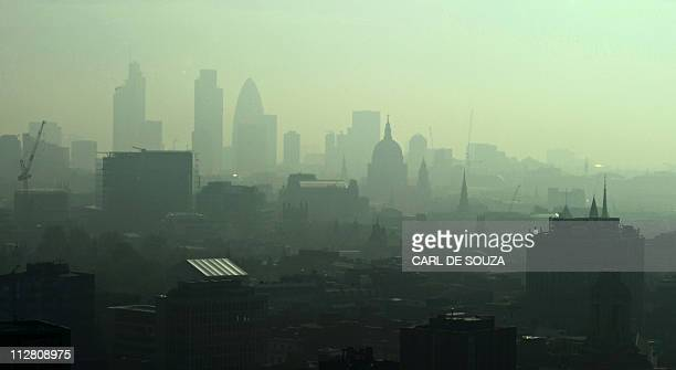 St Paul's Cathedral is seen in the early morning sunlight among the skyline through the smog in central London on April 22 2011 The British...
