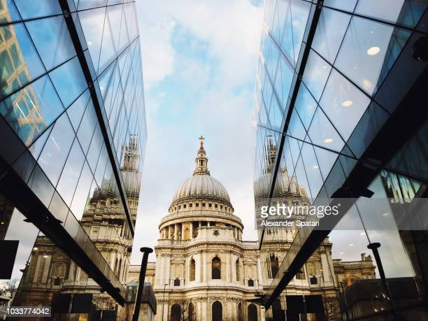 st. paul's cathedral reflection in modern skyscrapers, london, uk - london financial district stock photos and pictures