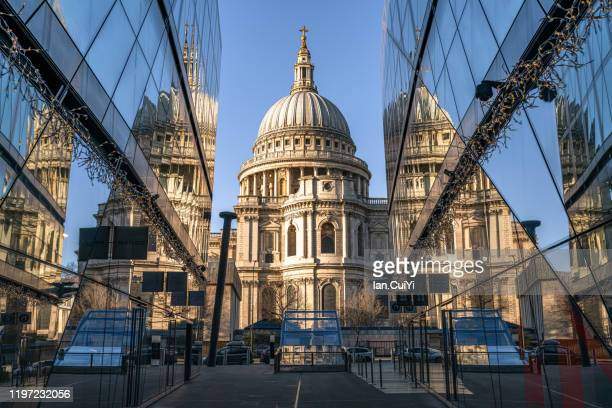 st paul's cathedral with reflections during sunrise - central london stock pictures, royalty-free photos & images