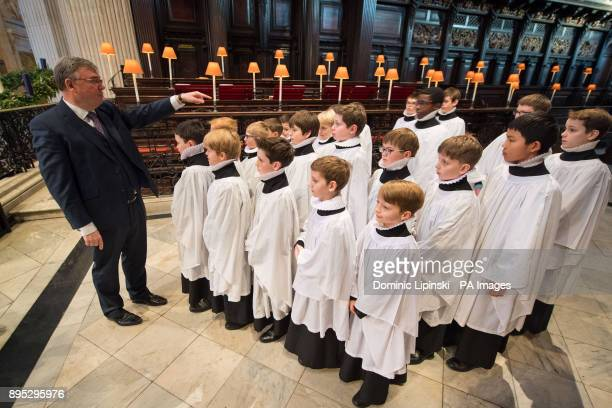 St Paul's Director of Music Andrew Carwood directs choristers in St Paul's Cathedral in London as they rehearse before their busiest weeks of the year