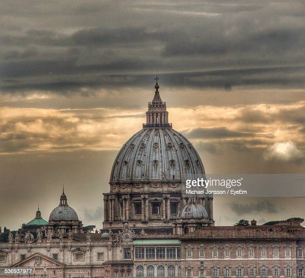 St Peter Basilica Against Cloudy Sky At Dusk