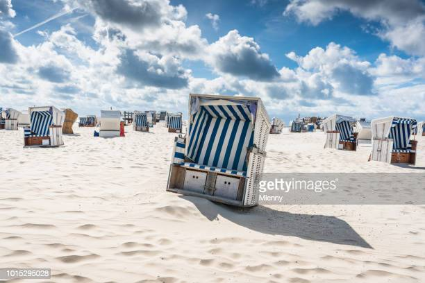 st. peter-ording hooded beach chairs nordsee germany - north sea stock pictures, royalty-free photos & images
