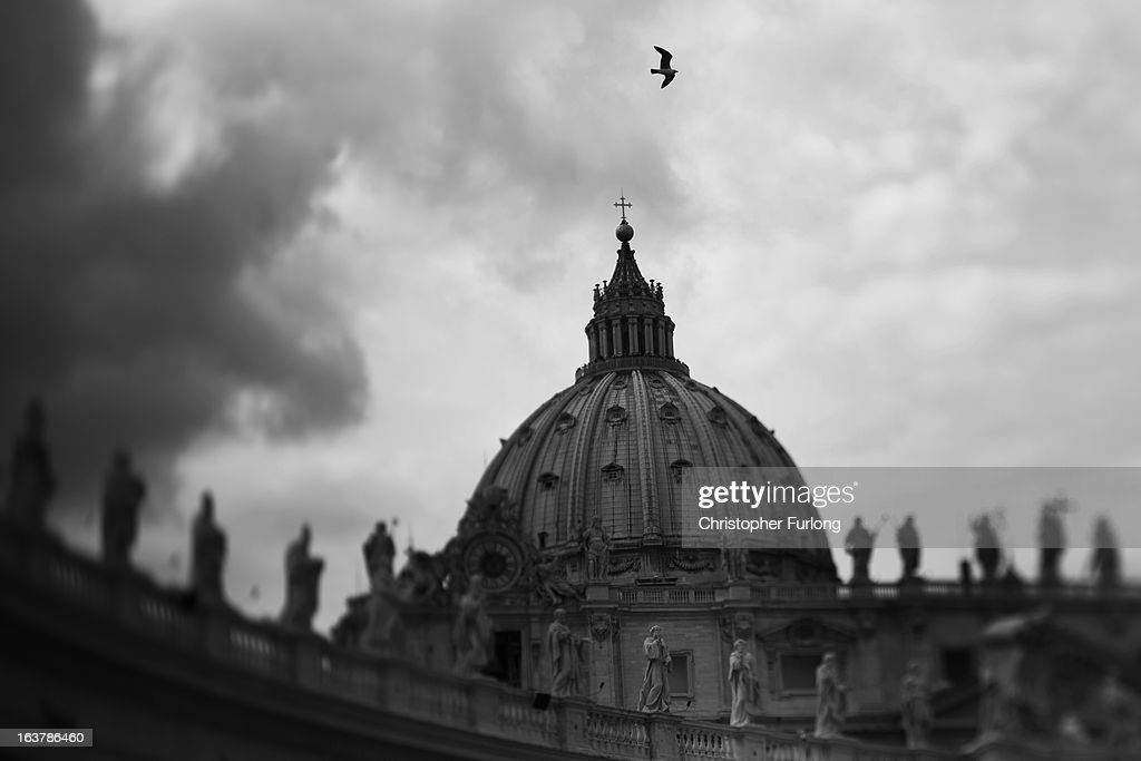 . St Peter's Basilica is seen trhough the pillars of the colonnade on March 15, 2013 in Vatican City, Vatican. Daily life continues around the vatican as romans prepare for the inauguration mass of Pope Francis, the first ever Latin American Pontiff.