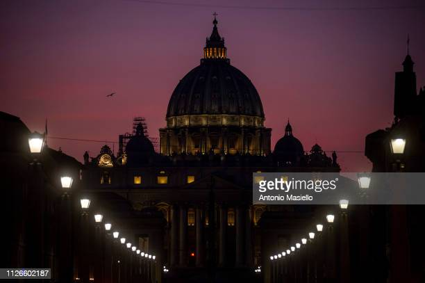 St Peter's Basilica is silhouetted at sunset during a prayer for the victims of sex abuse on February 21 in Rome Italy Last Thursday Pope Francis...