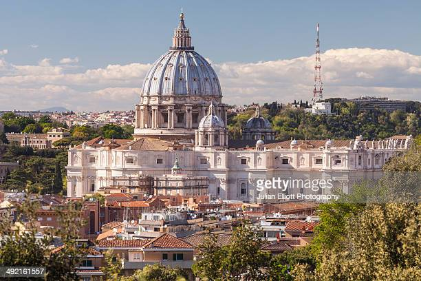 st peter's basilica over the rooftops of rome. - basilica stock pictures, royalty-free photos & images