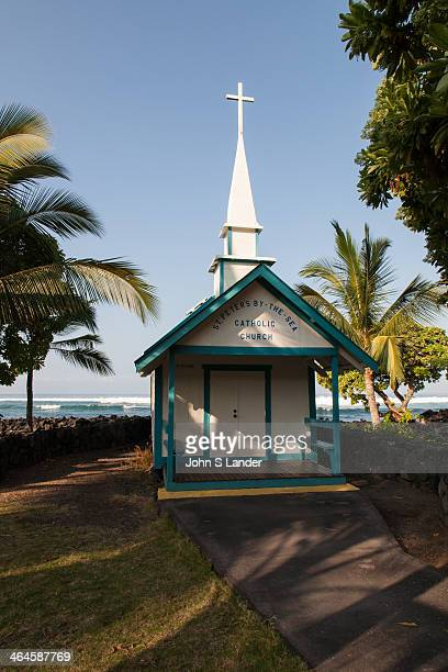 St Peter's by the Sea catholic church is located right on Keauhau Beach and surrounded by floral trees There are only a dozen pews and a tiny pulpit...