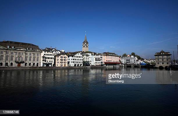 St Peter's church center is seen standing on the banks of the river Limmat in Zurich Switzerland on Friday Sept 16 2011The Swiss government lowered...