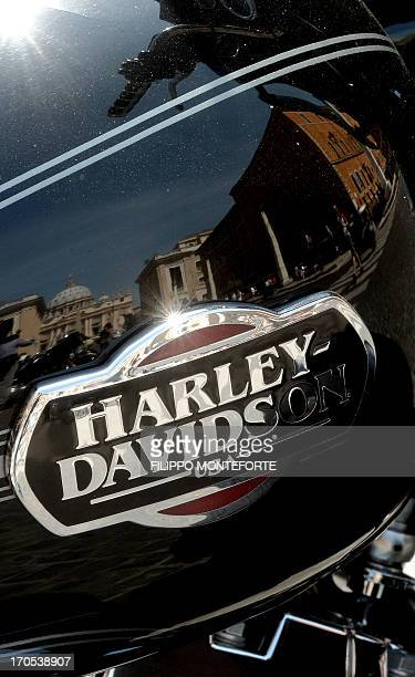 St Peter's dome is reflected on a HarleyDavidson motorbike during 110th Anniversary event in Rome on June 14 2013 Around 100000 HarleyDavidson owners...
